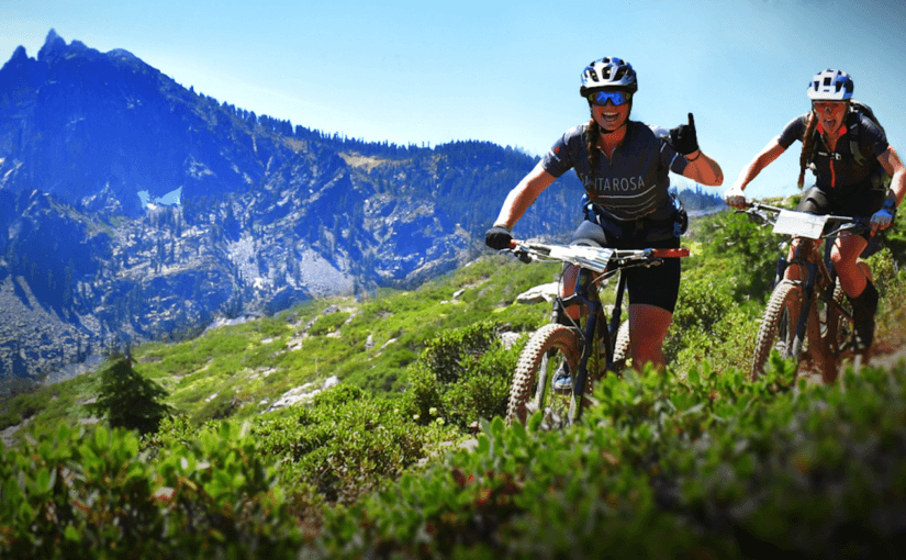 Two women smiling on mountain bikes