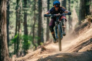 Woman Mountain bike racer catching air