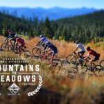 Mountains to Meadows logo over photo of bike racers climbing mountains