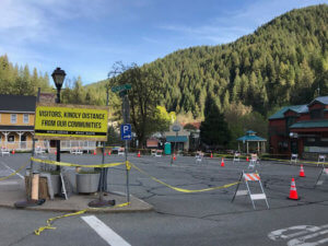 Downtown Downieville sign: Visitors, kindly distance from our communities