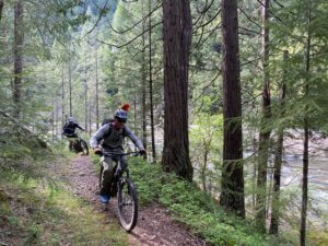 Trailcrew riding Santa Cruz Hecklers to Third Divide for work