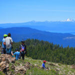 People on Mt. Hough overlooking Lake Almanor and Mt. Lassen