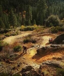 Trail worker digging trail.