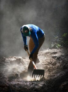 Trail worker digging