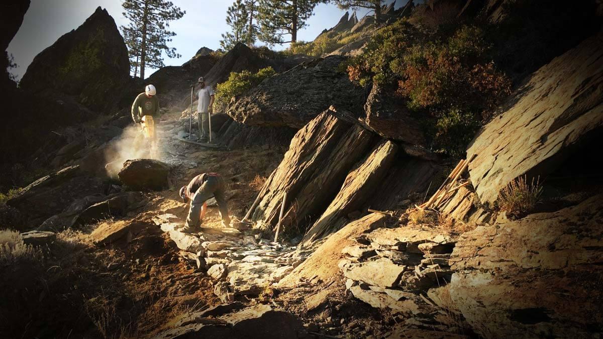 Trailcrew building in rocky terrain