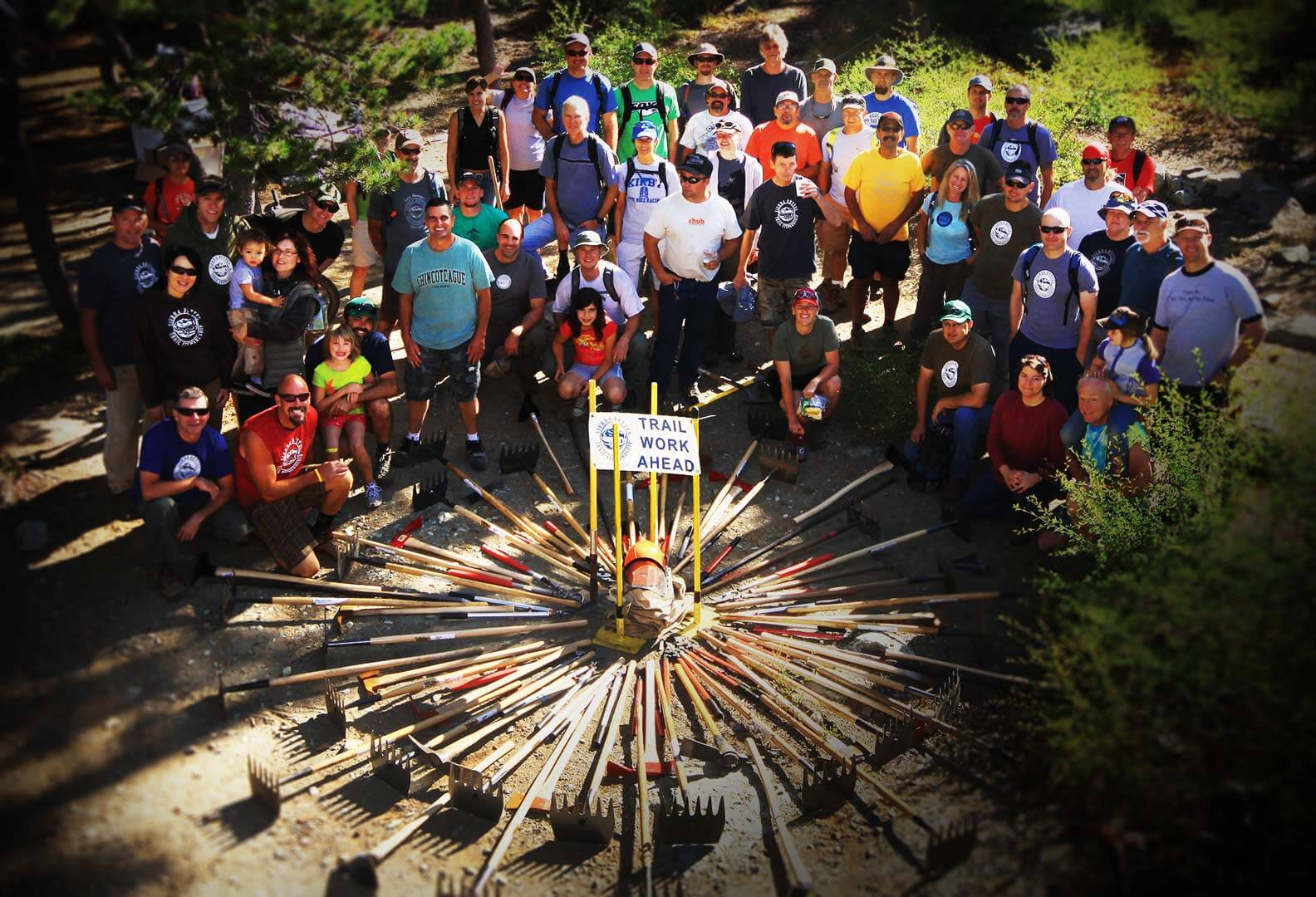 Large group of people and trail tools