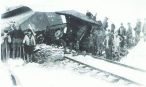 A Boca and Loyalton Locomotive sits across the tracks after this winter accident, circa 1905. Note the bucker plow (B&L No. 1) on the left, designed to push light snow off the tracks. (Loyalton Museum collection)